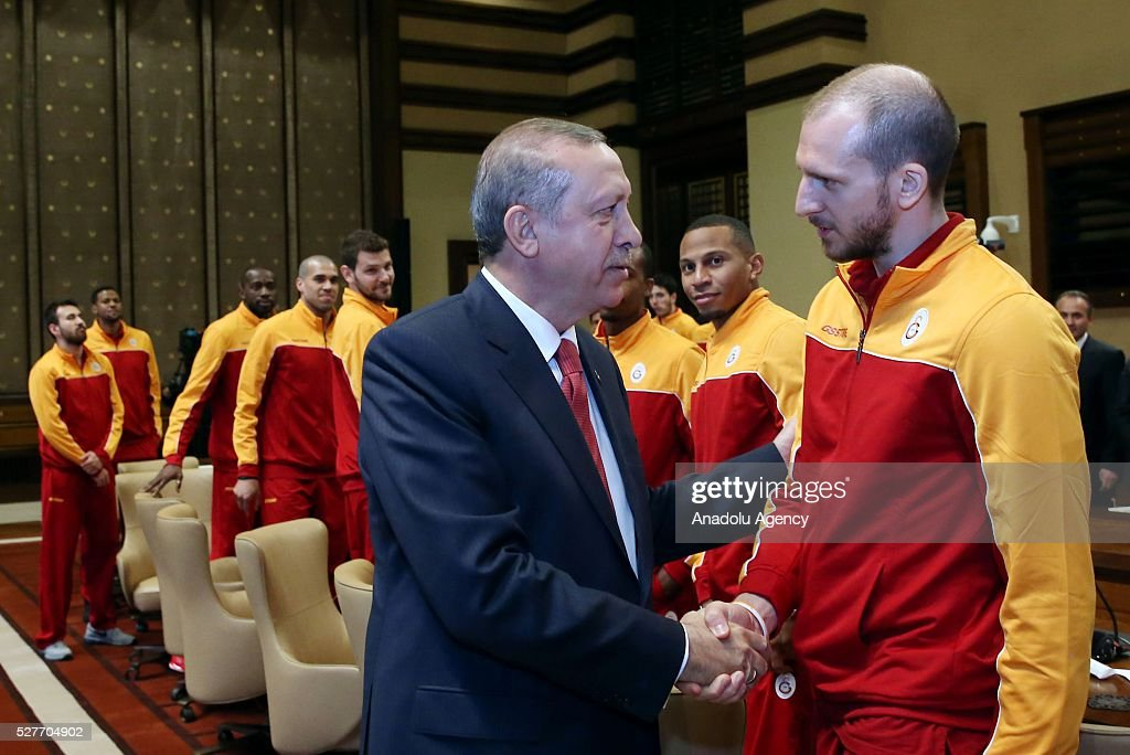 Turkish President Recep Tayyip Erdogan (L) shake hands with Sinan Guler (R) player of ULEB Eurocup champion Galatasaray Men's Basketball Team at Presidential Complex in Ankara, Turkey on May 3, 2016.