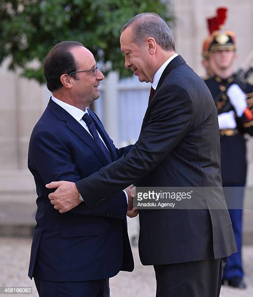Turkish President Recep Tayyip Erdogan shakes hand with French President Francois Hollande at the Elysee Presidential Palace in Paris France on...