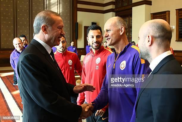 Turkish President Recep Tayyip Erdogan shakes hand with Galatasaray's goalkeeper coach Claudio Taffarel during the Galatasaray's visit at...
