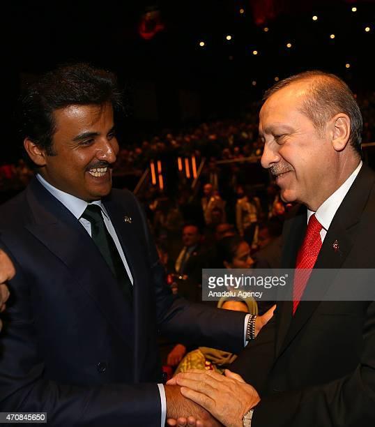 Turkish President Recep Tayyip Erdogan shakes hand with Qatar's Emir Sheikh Tamim bin Hamad Al Thani during a session within the High Level Peace...