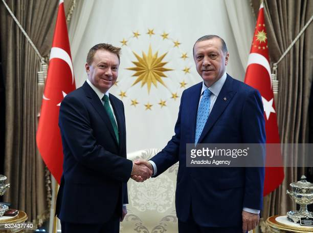 Turkish President Recep Tayyip Erdogan shakes hands with Australian Ambassador to Ankara Marc Innes Brown after receiving his letter of credence at...