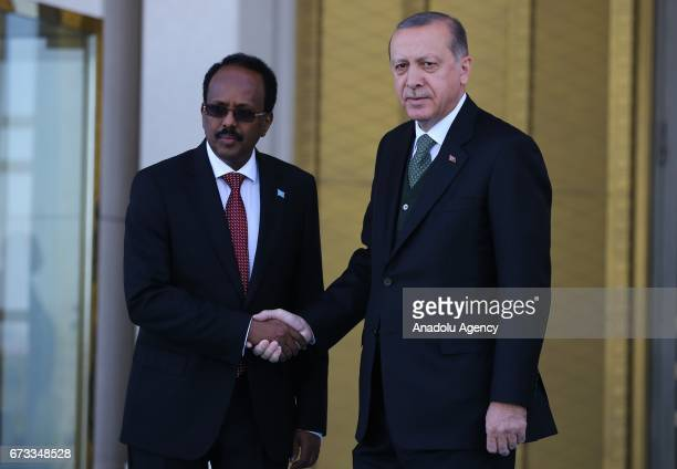 Turkish President Recep Tayyip Erdogan shakes hands with President of Somalia Mohamed Abdullahi Mohamed during an official welcoming ceremony at...