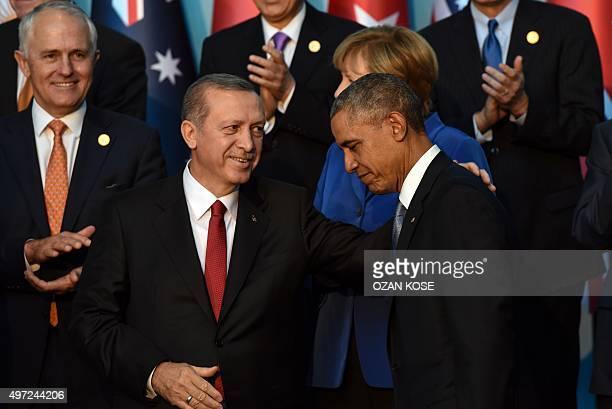 Turkish President Recep Tayyip Erdogan speaks with US President Barack Obama during the G20 Summit's family photo on November 152015 in Antalya...