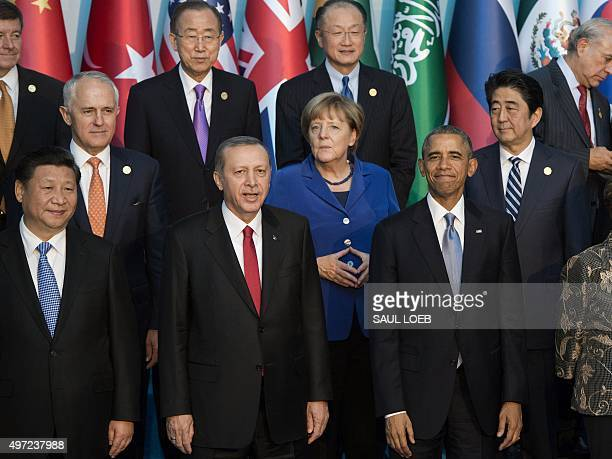 Turkish President Recep Tayyip Erdogan stands alongside Chinese President Hu Jintao German Chancelor Angela Merkel US President Barack Obama Japanese...