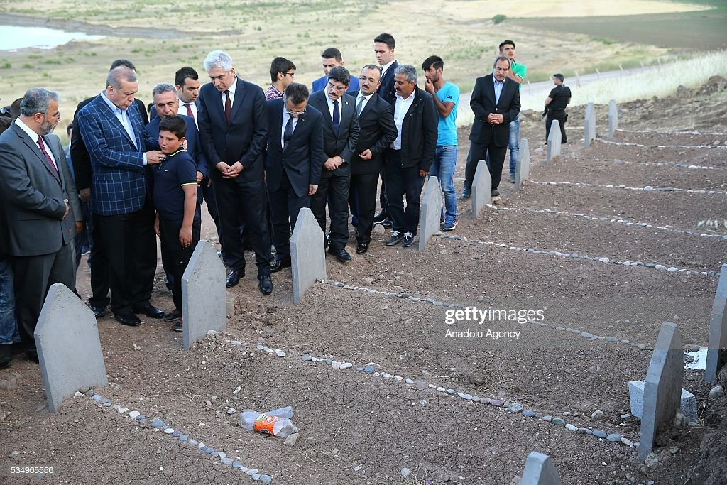 Turkish President Recep Tayyip Erdogan (2nd L) takes care with a kid during his condolence visit to the graves of the PKK's terrorist attack victims in Tanisik village of Diyarbakir Province of Turkey on May 28, 2016. PKK killed 16 people and injured 23 earlier this month with a bomb-laden truck attack in Durumlu village of Diyarbakir. PKK is recognized as a terrorist organization by several states and organizations, including the North Atlantic Treaty Organisation (NATO) , European Union (EU) and USA and several other countries around the world. PKK has been staged varied terrorist attacks on civilians over 30 years in Turkey and other countries.