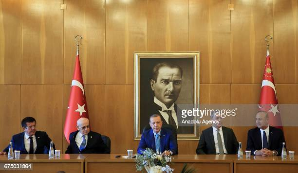 Turkish President Recep Tayyip Erdogan takes part in a press conference ahead of his departure for India at the Ataturk International Airport's...