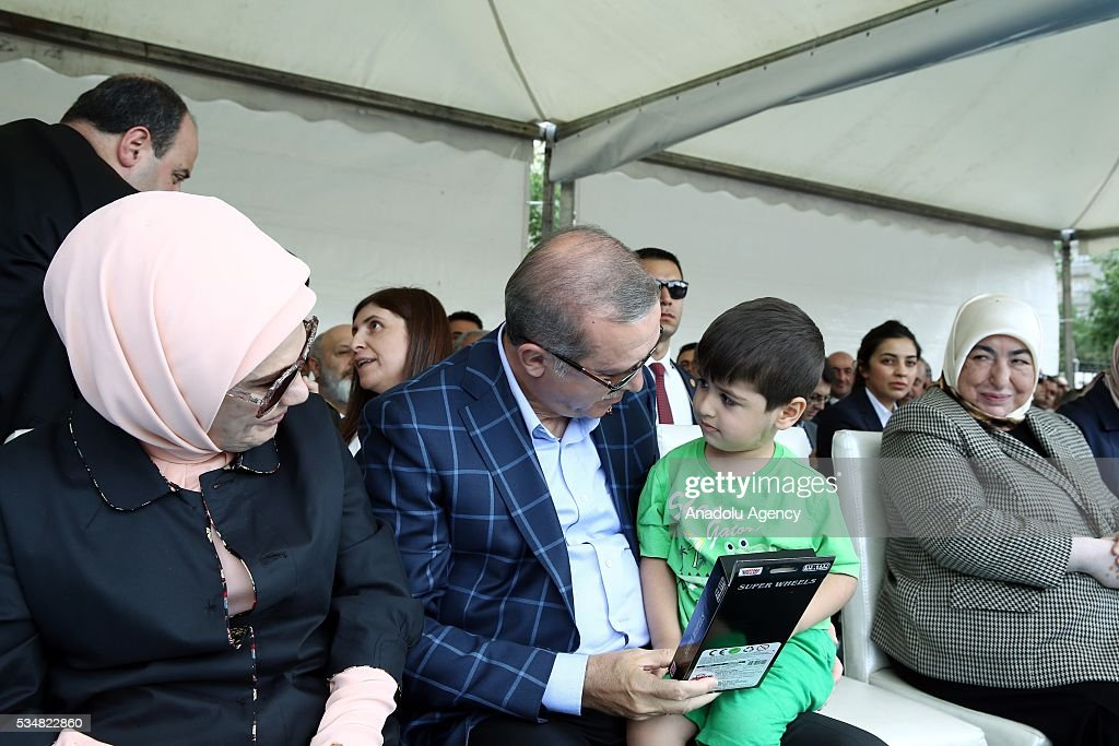 Turkish President Recep Tayyip Erdogan (C) talks with a child during an mass opening ceremony in Diyarbakir, Turkey on May 28, 2016.