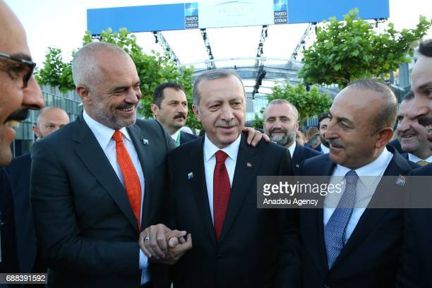 Turkish President Recep Tayyip Erdogan talks with Albania's Prime Minister Edi Rama during the NATO Leaders' Summit at the NATO headquarters in...