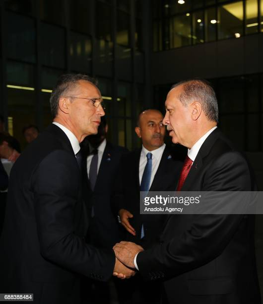 Turkish President Recep Tayyip Erdogan talks with NATO Secretary General Jens Stoltenberg during the NATO Leaders' Summit at the NATO headquarters in...