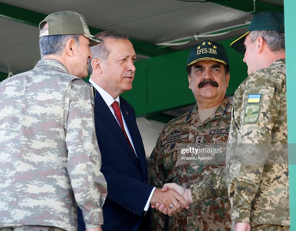 Turkish President Recep Tayyip Erdogan (2nd L), talks with participants during the Efes-2016 Combined Joint Live Fire Exercise at Seferihisar district of Izmir, Turkey on May 31, 2016. The Turkish-led multinational military exercises, Efes-2016 which started on May May 4, will be finished on June 04, 2016, aims to train participating units and staff in planning and conducting combined and joint operations, including logistics and command-control as well as to improve the level of interoperability among headquarters and forces.