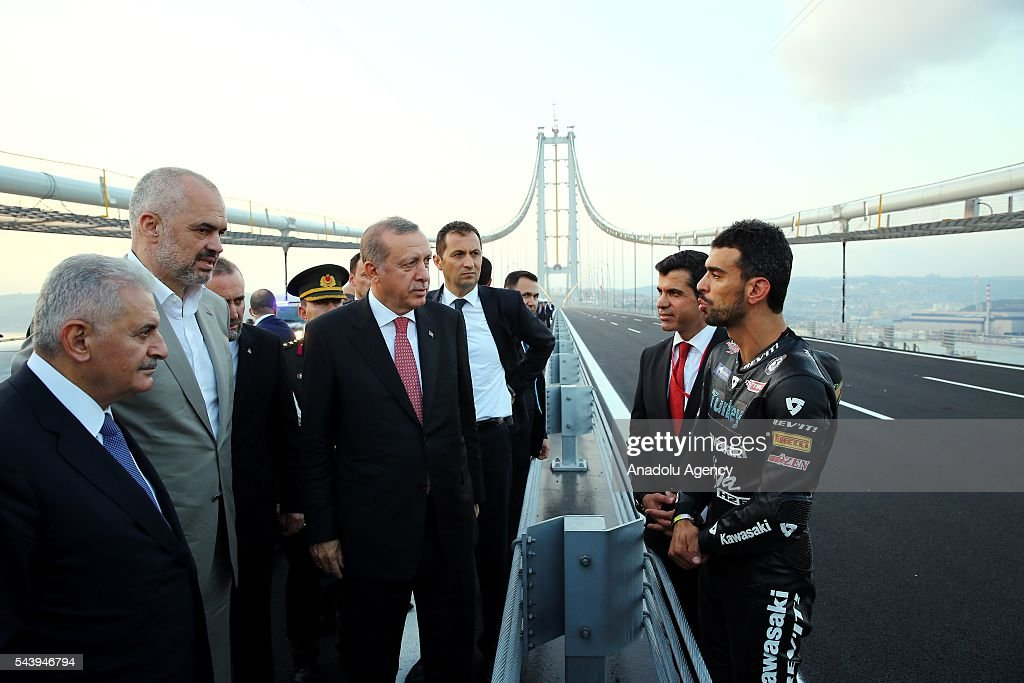 Turkish President Recep Tayyip Erdogan (C-L) talks with Turkish professional motorcycle racer Kenan Sofuoglu (R) during the opening ceremony of Osmangazi Bridge in Kocaeli, Turkey on June 30, 2016. Osmangazi Bridge is the fourth-longest suspension bridge in the world and second-longest bridge in Europe.