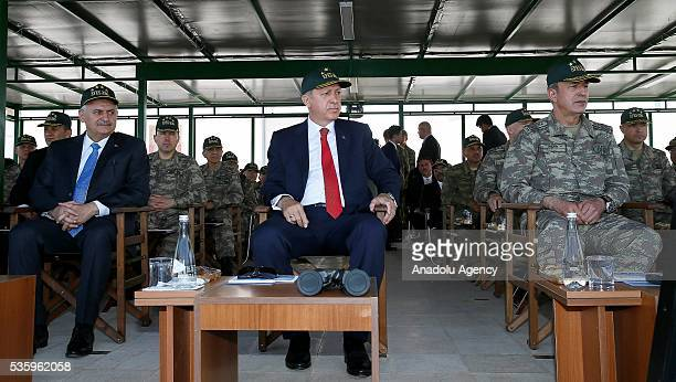 Turkish President Recep Tayyip Erdogan Turkish Prime Minister Binali Yildirim and Chief of the General Staff of the Turkish Armed Forces Hulusi Akar...