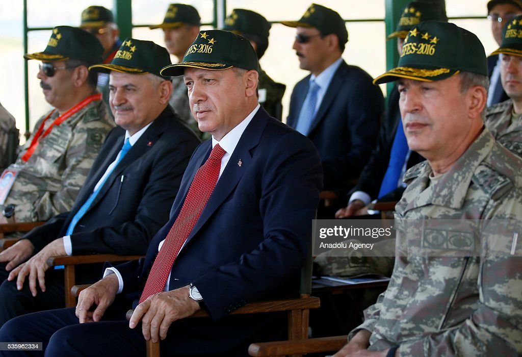 Turkish President Recep Tayyip Erdogan (2nd R), Turkish Prime Minister Binali Yildirim (2nd L) and Chief of the General Staff of the Turkish Armed Forces, Hulusi Akar (R) attend the Efes-2016 Combined Joint Live Fire Exercise at Seferihisar district of Izmir, Turkey on May 31, 2016. The Turkish-led multinational military exercises, Efes-2016 which started on May May 4, will be finished on June 04, 2016, aims to train participating units and staff in planning and conducting combined and joint operations, including logistics and command-control as well as to improve the level of interoperability among headquarters and forces.
