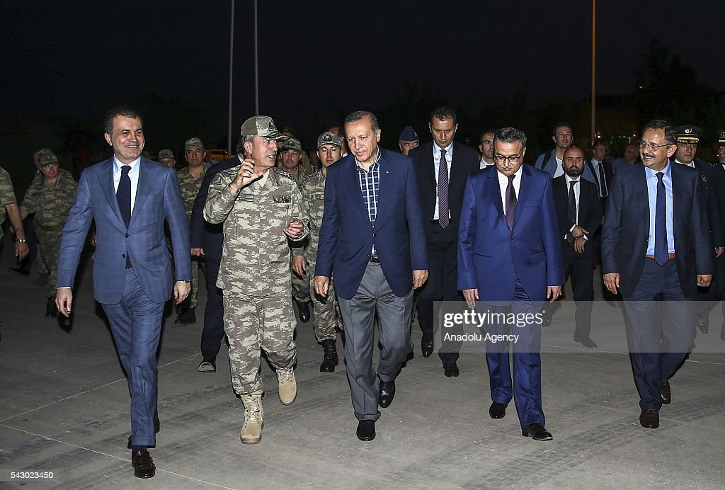 Turkish President Recep Tayyip Erdogan (3rd L) visits 172. Armored Brigade Command's 3. Tank Battalion campus prior to an Iftar (fast-breaking) Dinner in Cizre District of Sirnak, Turkey on Islamic holy month Ramadan on June 25, 2016.