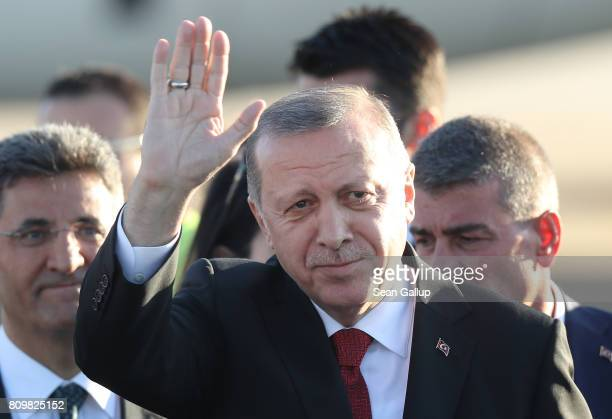Turkish President Recep Tayyip Erdogan waves as he arrives at Hamburg Airport for the Hamburg G20 economic summit on July 6 2017 in Hamburg Germany...