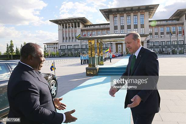 Turkish President Recep Tayyip Erdogan welcomes Gabonese President Ali Bongo Ondimba at the Presidential Palace in Ankara Turkey on May 12 2015
