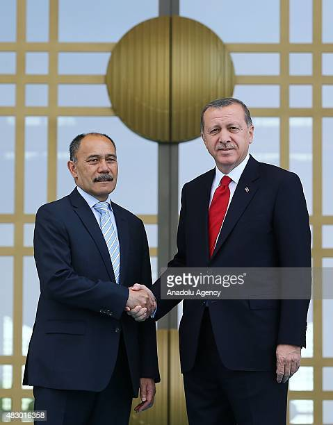 Turkish President Recep Tayyip Erdogan welcomes New Zealand's GovernorGeneral Jerry Mateparae at the Presidential Palace in capital Ankara Turkey on...