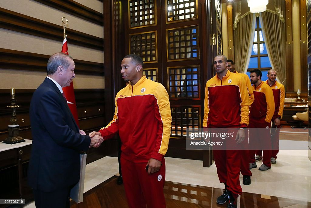 Turkish President Recep Tayyip Erdogan (L) welcomes player of Galatasaray Men's Basketball Team at Presidential Complex in Ankara, Turkey on May 3, 2016.