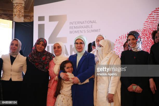 Turkish President Recep Tayyip Erdogan's wife Emine Erdogan hugs the 7 years old Syrian girl Bana Alabed as they pose for a photo during the opening...