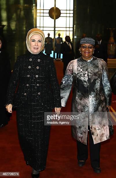 Turkish President Recep Tayyip Erdogan's wife Emine Erdogan poses with Malian President Ibrahim Boubacar Keita's wife Aminata Maiga Keita inside...