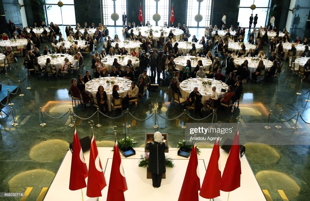 Turkish President Recep Tayyip Erdogan's wife Emine Erdogan (C) speaks during a dinner gathering business women, female athletes and artists at the Presidential Complex in Ankara, Turkey on March 14, 2017.