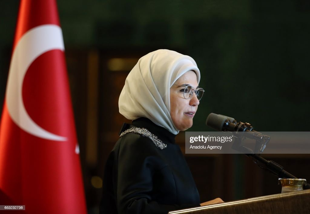 Turkish President Recep Tayyip Erdogan's wife Emine Erdogan (C) speaks during a dinner gathering business women, female athletes and artists at the Presidential Complex in Ankara, Turkey on March 14, 2017.