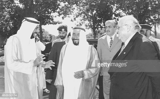 Turkish President Suleyman Demirel speaks with his Emirati counterpart Sheikh Zayed ibn Sultan alNahayan and Emirati Crown Prince Sheikh Khalifa ibn...