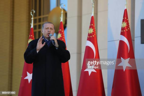 Turkish President Tayyip Erdogan gives a referendum victory speech to his supporters at the Presidential Palace on April 17 2017 in Ankara Turkey...