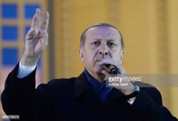 Turkish President Tayyip Erdogan holds a referendum victory speech to his supporters at the Presidential Palace on April 17 2017 in Ankara Turkey...