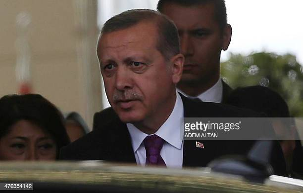 Turkish President Tayyip Erdogan looks on after arriving at Esenboga Airport in Ankara on June 8 2015 after Erdogan's ruling party lost in the June 7...