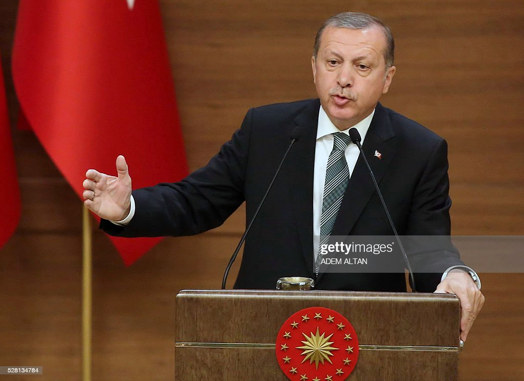 Turkish President Tayyip Erdogan speaks during the mukhtars meeting at the Presidential Palace in Ankara, Turkey May 4, 2016. / AFP / ADEM