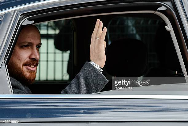 Turkish President's son Bilal Erdogan waves at supporters on November 1 2015 after casting his vote for Turkey's legislative election at a polling...