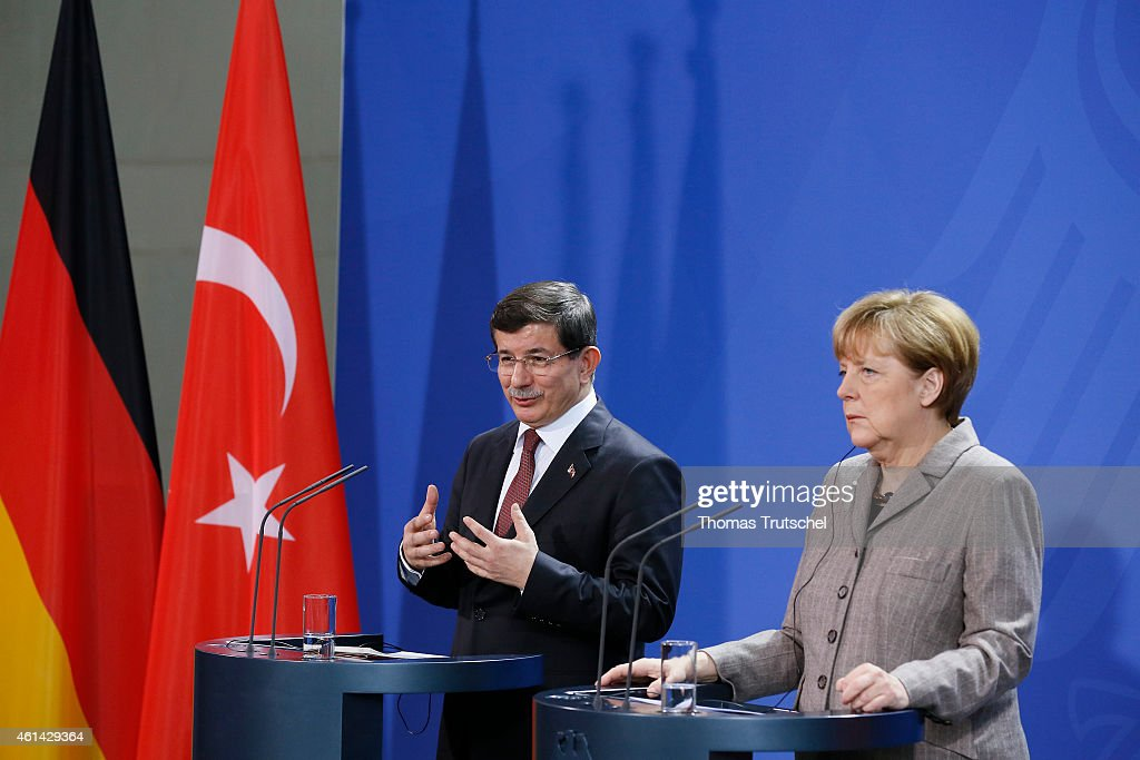 Turkish Prime Minister <a gi-track='captionPersonalityLinkClicked' href=/galleries/search?phrase=Ahmet+Davutoglu&family=editorial&specificpeople=4940018 ng-click='$event.stopPropagation()'>Ahmet Davutoglu</a> and German Chancellor Angela Merkel speaks to the media after their meeting at the Chancellery on January 12, 2015 in Berlin, Germany. It is Mr. Davutoglu's first visit in Germany since his inauguration.