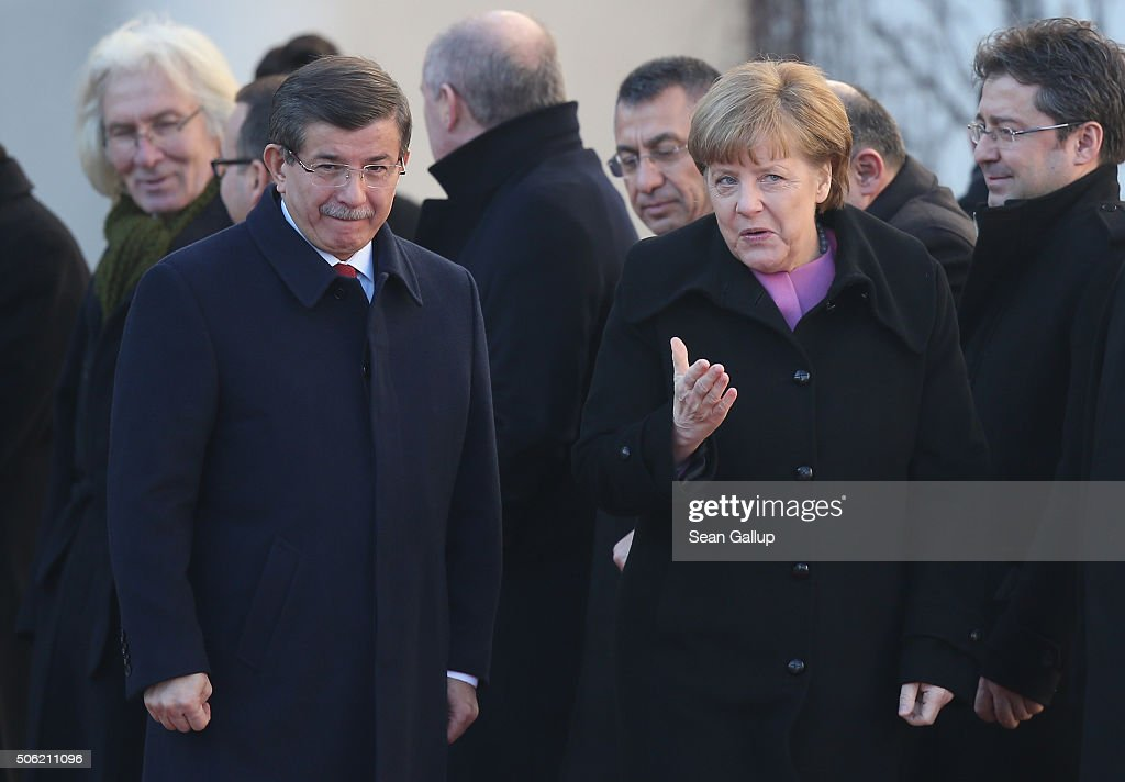 Turkish Prime Minister <a gi-track='captionPersonalityLinkClicked' href=/galleries/search?phrase=Ahmet+Davutoglu&family=editorial&specificpeople=4940018 ng-click='$event.stopPropagation()'>Ahmet Davutoglu</a> and German Chancellor <a gi-track='captionPersonalityLinkClicked' href=/galleries/search?phrase=Angela+Merkel&family=editorial&specificpeople=202161 ng-click='$event.stopPropagation()'>Angela Merkel</a> walk together following Devatoglu's arrival prior to German-Turkish government consultations at the Chancellery on January 22, 2016 in Berlin, Germany. The two governments are meeting amidst Europe's need for cooperation from Turkey in stemming the flow of refugees and migrants seeking asylum in Europe as well as in the ongoing military campaign against the Islamic State (IS).