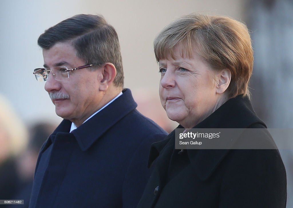 Turkish Prime Minister <a gi-track='captionPersonalityLinkClicked' href=/galleries/search?phrase=Ahmet+Davutoglu&family=editorial&specificpeople=4940018 ng-click='$event.stopPropagation()'>Ahmet Davutoglu</a> and German Chancellor Angela Merkel listen to their countries' respective national anthems following Devatoglu's arrival for German-Turkish government consultations at the Chancellery on January 22, 2016 in Berlin, Germany. The two governments are meeting amidst Europe's need for cooperation from Turkey in stemming the flow of refugees and migrants seeking asylum in Europe as well as in the ongoing military campaign against the Islamic State (IS).