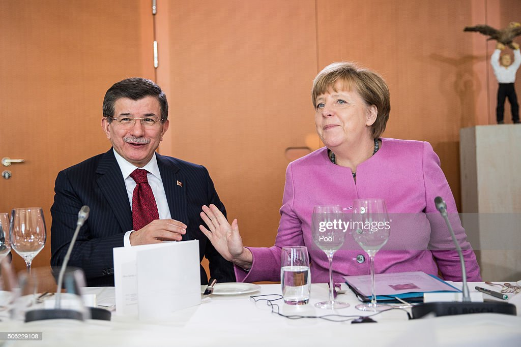 Turkish Prime Minister <a gi-track='captionPersonalityLinkClicked' href=/galleries/search?phrase=Ahmet+Davutoglu&family=editorial&specificpeople=4940018 ng-click='$event.stopPropagation()'>Ahmet Davutoglu</a> and German Chancellor <a gi-track='captionPersonalityLinkClicked' href=/galleries/search?phrase=Angela+Merkel&family=editorial&specificpeople=202161 ng-click='$event.stopPropagation()'>Angela Merkel</a> during German-Turkish government consultations at the Chancellery on January 22, 2016 in Berlin, Germany. The two governments are meeting amidst Europe's need for cooperation from Turkey in stemming the flow of refugees and migrants seeking asylum in Europe as well as in the ongoing military campaign against the Islamic State (IS).