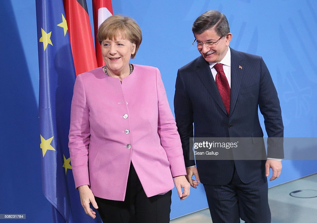 Turkish Prime Minister <a gi-track='captionPersonalityLinkClicked' href=/galleries/search?phrase=Ahmet+Davutoglu&family=editorial&specificpeople=4940018 ng-click='$event.stopPropagation()'>Ahmet Davutoglu</a> and German Chancellor <a gi-track='captionPersonalityLinkClicked' href=/galleries/search?phrase=Angela+Merkel&family=editorial&specificpeople=202161 ng-click='$event.stopPropagation()'>Angela Merkel</a> depart after speaking to the media following German-Turkish government consultations at the Chancellery on January 22, 2016 in Berlin, Germany. The two governments are meeting amidst Europe's need for cooperation from Turkey in stemming the flow of refugees and migrants seeking asylum in Europe as well as in the ongoing military campaign against the Islamic State (IS).