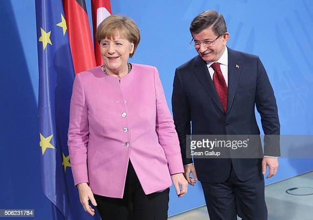 Turkish Prime Minister Ahmet Davutoglu and German Chancellor Angela Merkel depart after speaking to the media following GermanTurkish government...