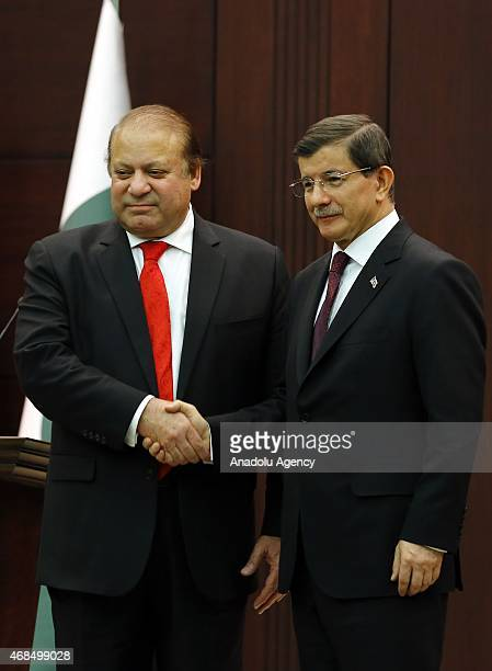 Turkish Prime Minister Ahmet Davutoglu and Pakistani Prime Minister Nawaz Sharif shake hands after their joint press conference at the Prime Ministry...