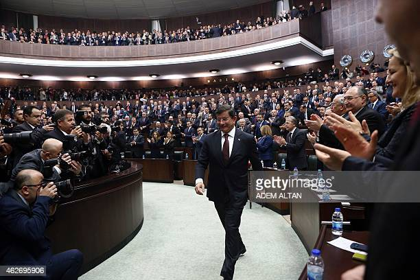 Turkish Prime Minister Ahmet Davutoglu arrives on February 3 2015 at the parliament in Ankara to address deputies of the ruling Justice and...