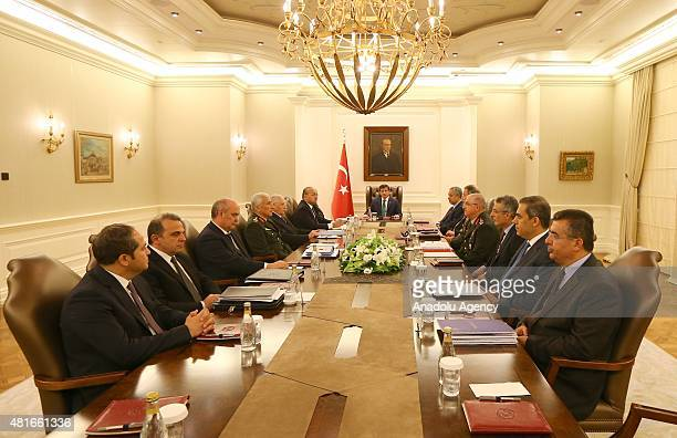 Turkish Prime Minister Ahmet Davutoglu chairs an emergency Special Security Meeting in Ankara Turkey on July 23 after gunfire from Syria across the...