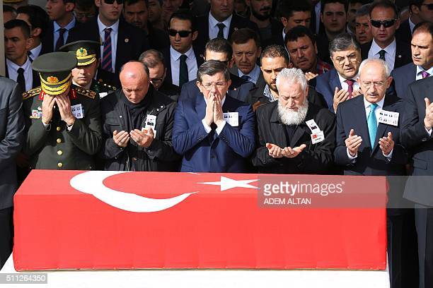 Turkish Prime Minister Ahmet Davutoglu Chief of Staff General Hulusi Akar main opposition Republican People's Party leader Kemal Kilicdaroglu and...