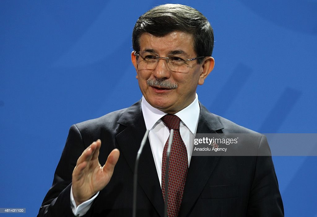 Turkish Prime Minister <a gi-track='captionPersonalityLinkClicked' href=/galleries/search?phrase=Ahmet+Davutoglu&family=editorial&specificpeople=4940018 ng-click='$event.stopPropagation()'>Ahmet Davutoglu</a> delivers a speech as German Chancellor Angela Merkel (not seen) listens to him during a joint press conference held after talks at the German Chancellery on January 12, 2015 in Berlin, Germany.