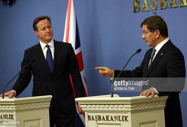 Turkish Prime Minister Ahmet Davutoglu gestures as he speaks during a joint press conference with his British counterpart David Cameron in Ankara...