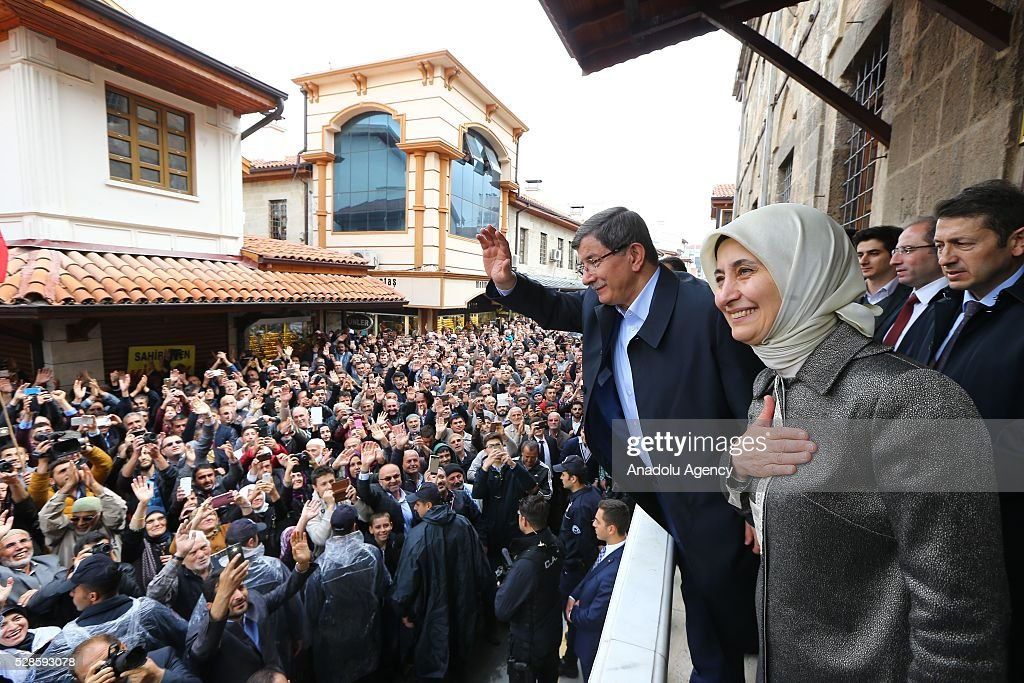 Turkish Prime Minister Ahmet Davutoglu greets citizens, together with his wife Sare Davutoglu, after performing friday prayer in his hometown Konya, Turkey on May 6, 2016.