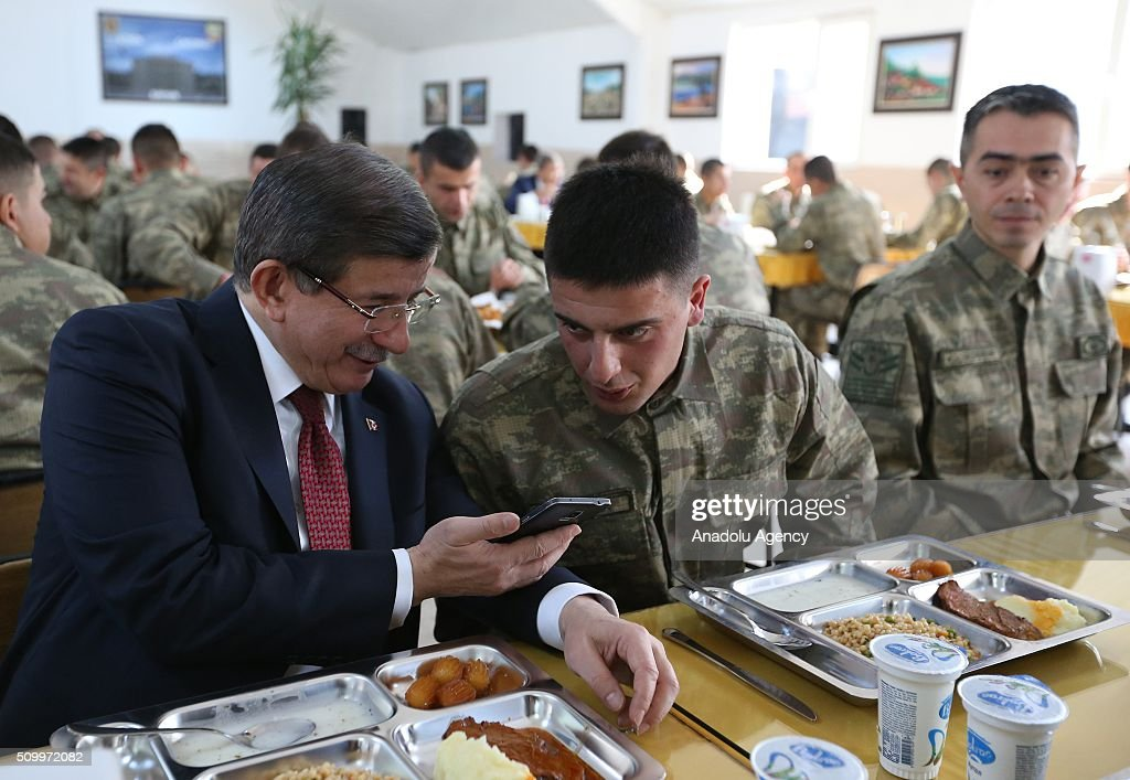 Turkish Prime Minister Ahmet Davutoglu (L) has lunch with the soldiers during his visit at the 3rd Army Commandership in Erzincan, Turkey on February 13, 2016.