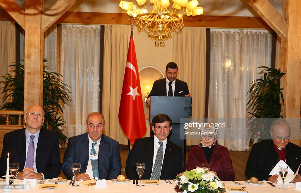 Turkish Prime Minister <a gi-track='captionPersonalityLinkClicked' href=/galleries/search?phrase=Ahmet+Davutoglu&family=editorial&specificpeople=4940018 ng-click='$event.stopPropagation()'>Ahmet Davutoglu</a> (C), his wife <a gi-track='captionPersonalityLinkClicked' href=/galleries/search?phrase=Sare+Davutoglu&family=editorial&specificpeople=6828135 ng-click='$event.stopPropagation()'>Sare Davutoglu</a> (2nd R), Iraqi Vice President <a gi-track='captionPersonalityLinkClicked' href=/galleries/search?phrase=Ayad+Allawi&family=editorial&specificpeople=210652 ng-click='$event.stopPropagation()'>Ayad Allawi</a> (2nd L) and Saudi Prince Turki bin Faisal Al Saud (R) attend a dinner at the Rixos Hotel in Davos, Switzerland on January 21, 2015.