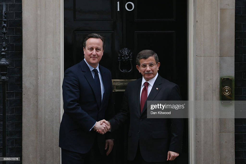 Turkish Prime Minister Ahmet Davutoglu (R) is greeted by British Prime Minister David Cameron at 10 Downing Street on January 18, 2016 in London, England. Campaigns by writers associations English PEN, Wales PEN Cymru and Scottish PEN have called for Mr Cameron to urge the Turkish government to halt its crackdown on freedom of speech, amid the growing persecution of journalists, writers and publishers in Turkey.