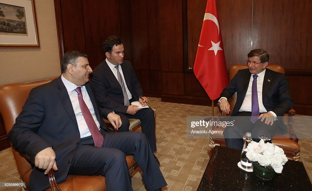 Turkish Prime Minister Ahmet Davutoglu (R) meets Former Prime Minister of Syria, Riyad Farid Hijab (L) during his official visit in Doha, Qatar on April 28, 2016.