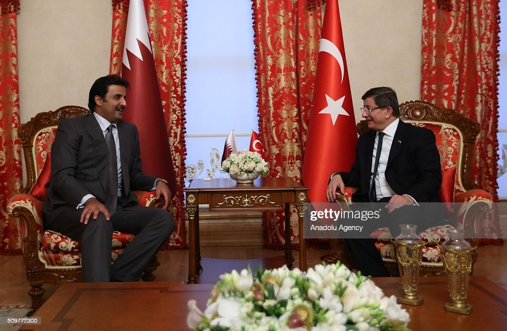 Turkish Prime Minister Ahmet Davutoglu (R) meets Qatar's Emir Sheikh Tamim bin Hamad Al Thani (L) at the Dolmabahce Prime Ministry Office in Istanbul, Turkey on February 12, 2016.